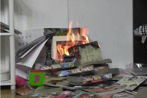地震による電気ストーブ発火事故
